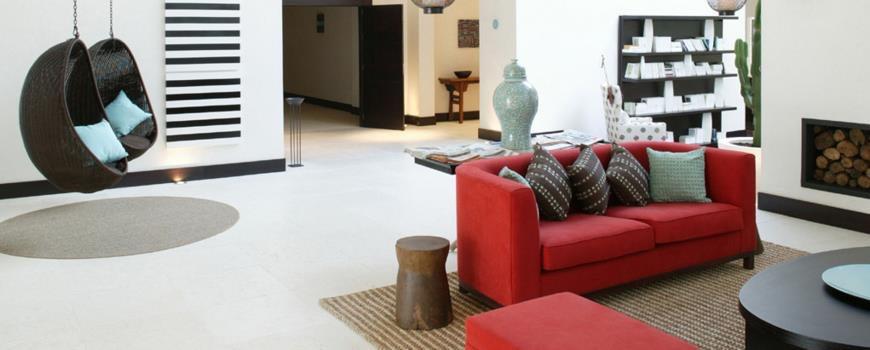 Combinación de mármol y madera - NH Sotogrande